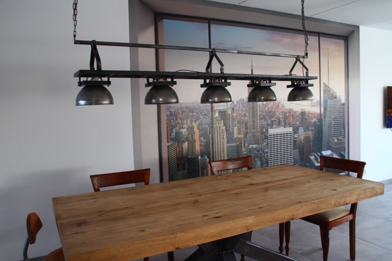 Industrial hanging lamp above a dining table