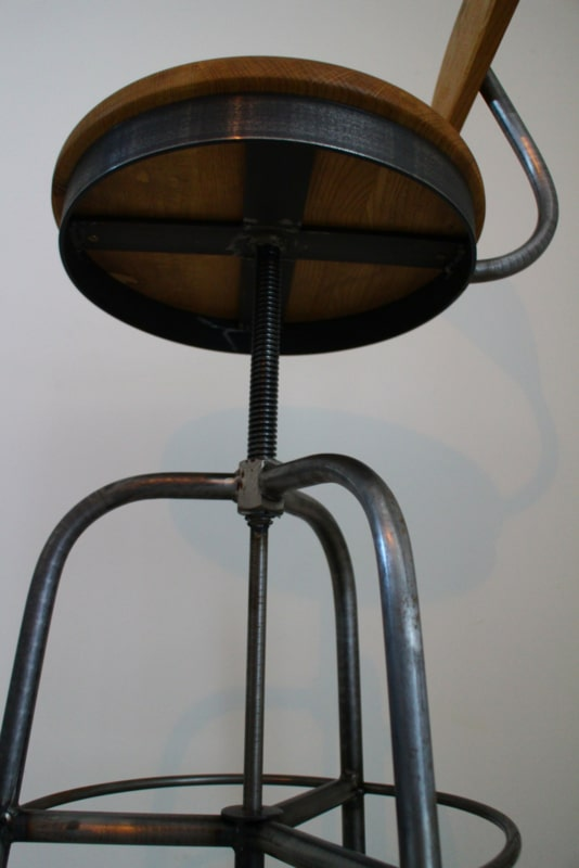 Industrial stool adjustable in height with backrest