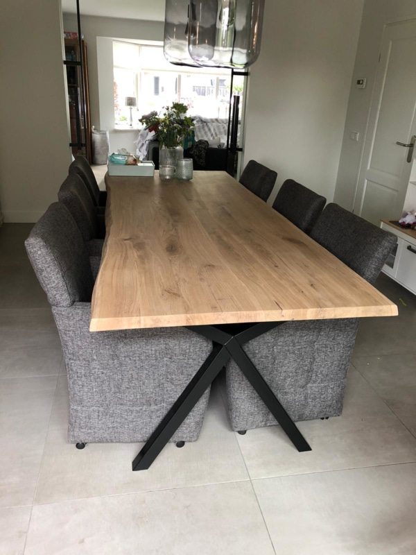 Tree trunk dining table with X legs