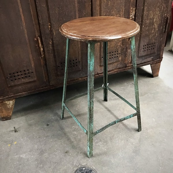 Metal bar stool in vintage green