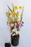 Dried flowers in glass apothecary jar