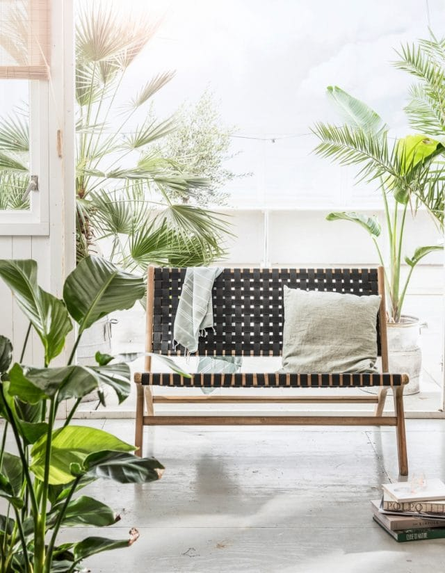 Garden bench with woven armrests seat
