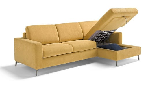 The spacious storage compartment of the Lisbona sofa bed with longchair