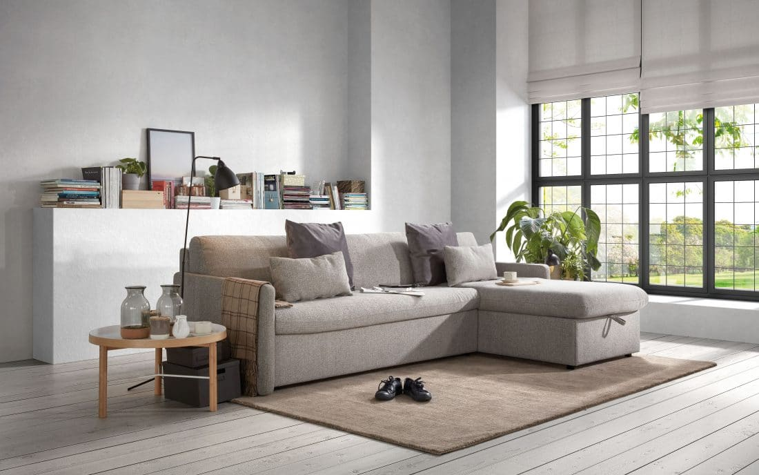 Sofa bed Marnix with longchair with storage space during the day