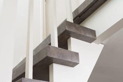 betonlook trap,roestbruin trap,betonnen trap,stairz traprenovatie,natuursteen trap,stenen trap
